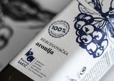 The brand identity and packaging design for an all-natural chokeberry juice