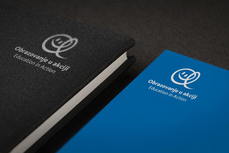 Dizajn logotipa Education in Action, rokovnik